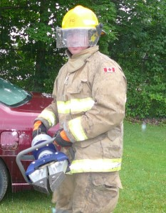"Firefighter Chuck Smith holding the new ""Jaws of Life"""